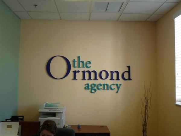 Dimensional Acrylic graphics mounted on interior wall
